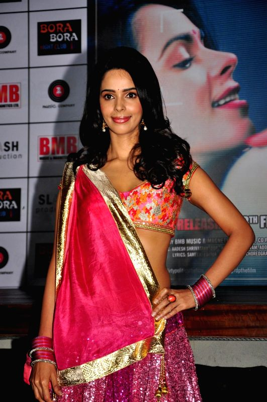Actress Mallika Sherawat during music launch of film Dirty Politics in Mumbai. - Mallika Sherawat