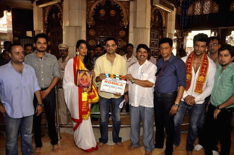 Actress Mughda Godse and actor Kushal Tandon visit Siddhivinayak Temple for the muhurat of her upcoming film Romila in Mumbai on June 4, 2015.