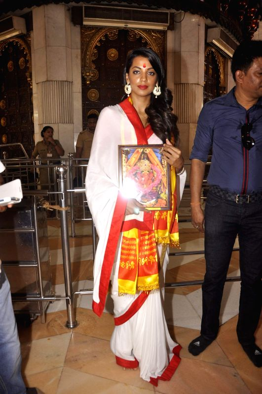 Actress Mughda Godse visits Siddhivinayak Temple for the muhurat of her upcoming film Romila in Mumbai on June 4, 2015.