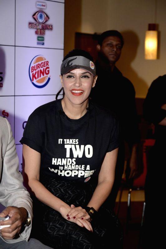 :Mumbai: Actress Neha Dhupia during the launch of the Big Boss Whopper in association with Big Boss Season 9, in New Delhi on Nov 17, 2015. (Photo: IANS/PIB).