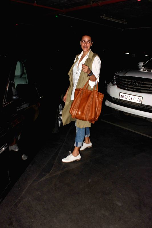 Actress Neha Dhupia spotted at the international airport in Mumbai, on May 30, 2015. - Neha Dhupia