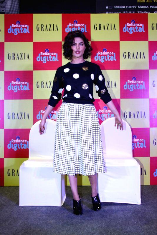 Actress Priyanka Chopra launches latest Grazia Magazine cover at Reliance Digital store in Mumbai on Dec 17, 2014.