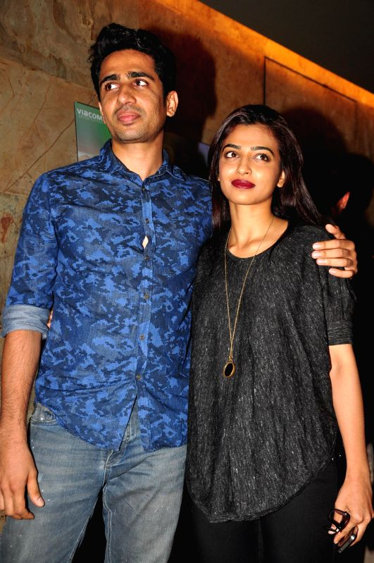 Actress Radhika Apte and Gulshan Devaiah during the special screening of film Margarita With A Straw in Mumbai on 13th April 2015. - Radhika Apte