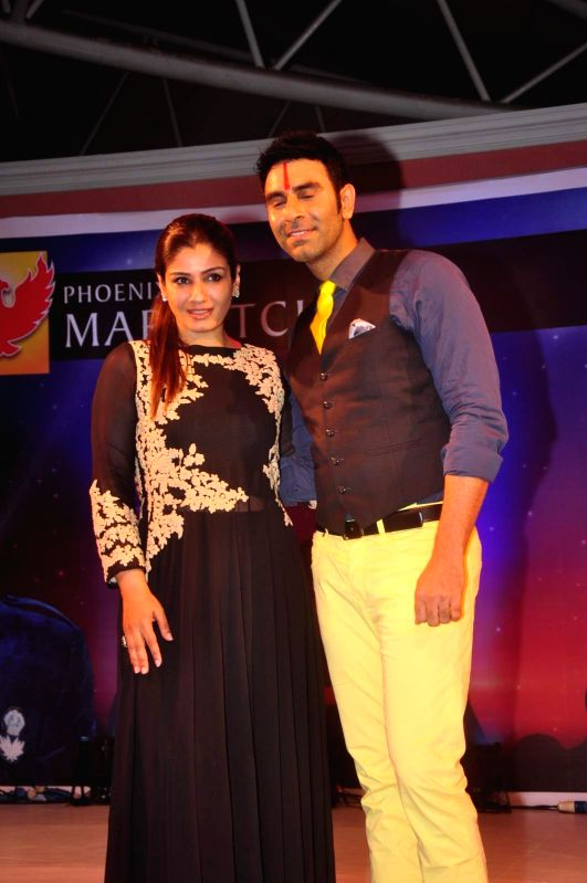 Actress Raveena Tandon and choreographer Sandip Soparrkar during the opening ceremony of 2nd edition of India Dance Week in Mumbai on April 25, 2015. - Raveena Tandon