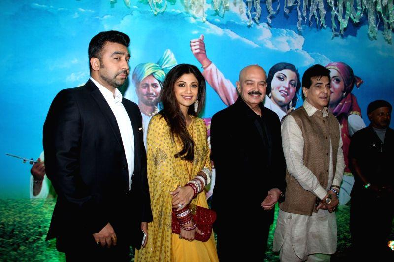 Actress Shilpa Shetty with her husband businessman Raj Kundra during the Baisakhi celebration in Mumbai on April 14, 2015. - Shilpa Shetty and Raj Kundra