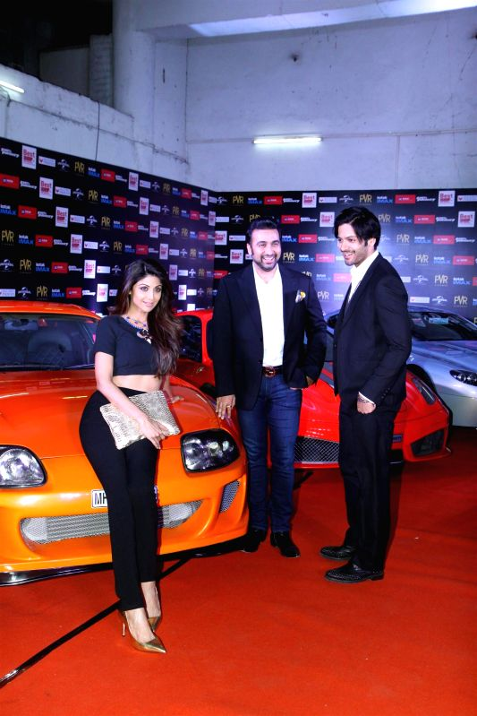 Actress Shilpa Shetty with her husband Raj Kundra and actor Ali Fazal during the premier show of the film Fast & Furious  in Mumbai on April 1, 2015. - Shilpa Shetty and Raj Kundra