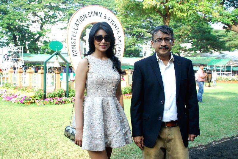 Actress Shriya Saran during the ABV Nucleus Indian 2000 Guineas (Grade 1) at Mahalaxmi race course in Mumbai, on Dec 21, 2014.