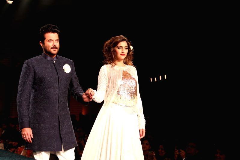 Actress Sonam Kapoor with her father and actor Anil Kapoor during Manish Malhotra's fashion show in Mumbai, on April 4, 2015, held to support actor Shabana Azmi`s cause of the Mijwan village ... - Sonam Kapoor and Manish Malhotra