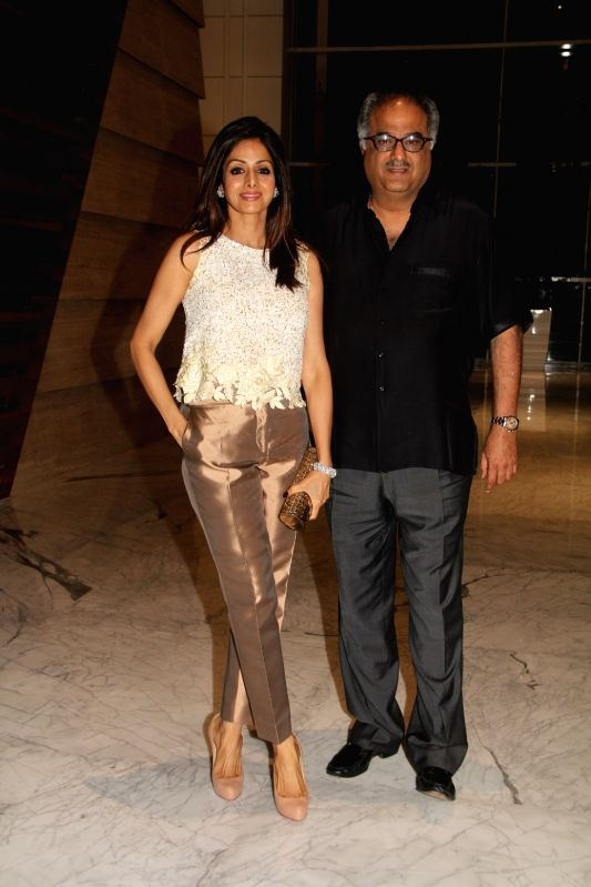 Actress Sridevi and filmmaker Bonny Kapoor during the 50th birthday of Sangeethi Seetharaman, in Mumbai, on April 27, 2015. Politician Amar Singh hosted the party for Sangeethi Seetharaman ... - Sridevi and Kapoor