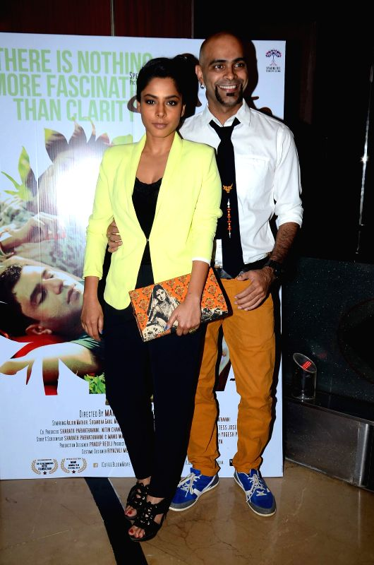 Actress Sugandha Garg with husband Raghu Ram during screening film Coffee Bloom in Mumbai on March 5, 2015. - Sugandha Garg