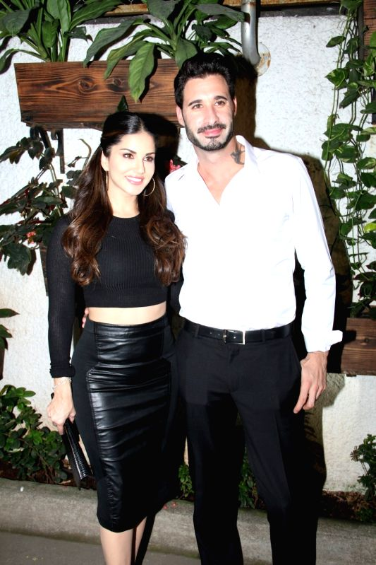 Actress Sunny Leone along with her husband Daniel Weber during the special screening of film Ek Paheli Leela in Mumbai on April 9, 2015. - Sunny Leone