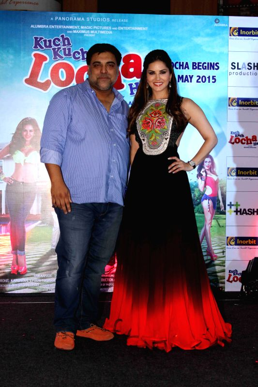 Actress Sunny Leone and actor Ram Kapoor promote their upcoming film Kuch Kuch Locha Hai by performing live at Inorbit Mall in Malad Mumbai, on April 25, 2015. - Sunny Leone and Kapoor