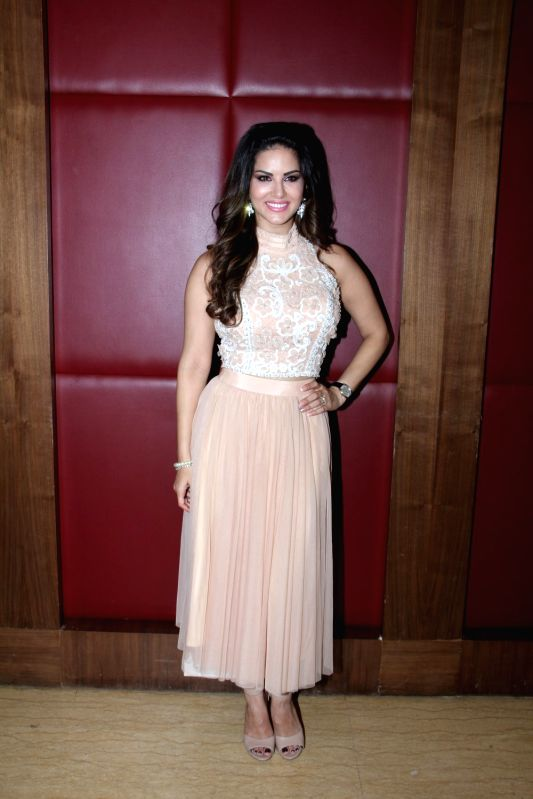 Actress Sunny Leone during a media interaction at the promotion of film Kuch Kuch Locha Hai in Mumbai. - Sunny Leone