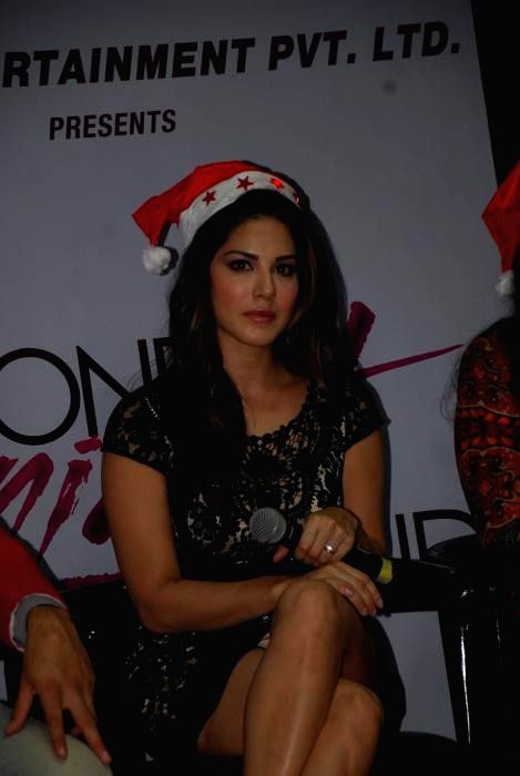 Actress  Sunny Leone during promotions of her up-coming film  ` One Night  Stand` in Mumbai, on Dec. 24, 2014. - Sunny Leone