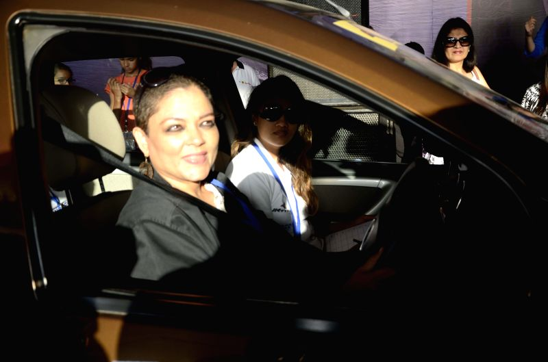 Actress Tanvi Azmi participates in a car rally organised on International Women's Day in Mumbai, on March 8, 2015. - Tanvi Azmi