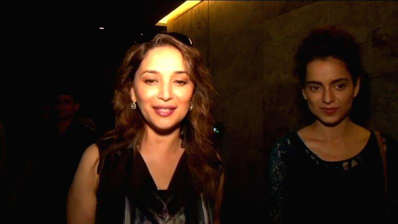 Actresses Madhuri Dixit and Kangana Ranaut during a special screening of the film `Tanu Weds Manu Returns` in Mumbai on May 25, 2015. - Madhuri Dixit and Kangana Ranaut