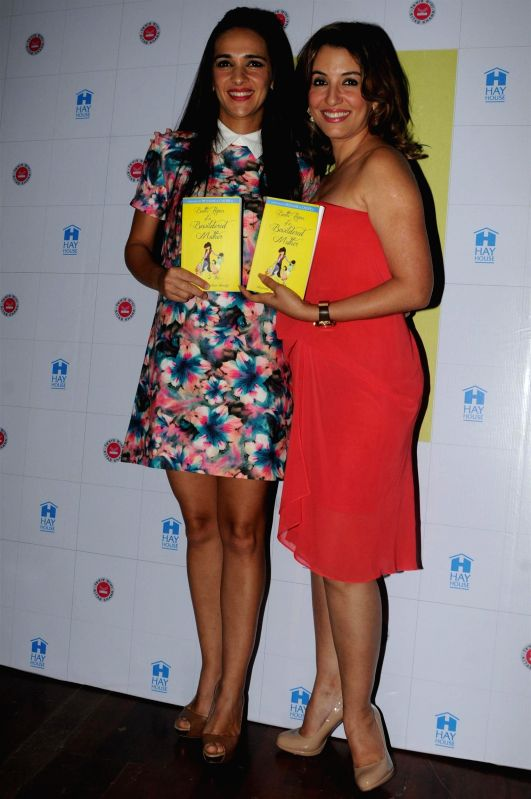 Actresses Tara Sharma and Perizaad Zorabian, during the book reading session of Battle Hymn of a Bewildered Mother written by author Shunali Khullar Shroff in Mumbai on April 24, 2015. - Tara Sharma and Perizaad Zorabian