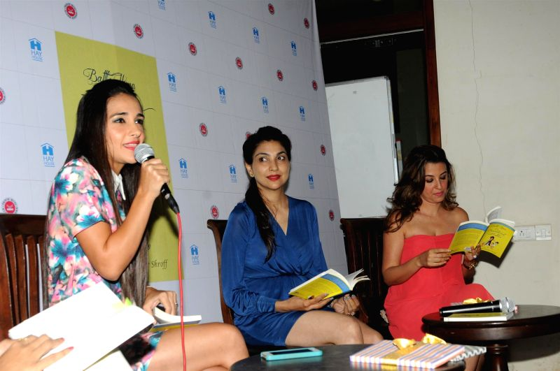 Actresses Tara Sharma and Perizaad Zorabian, during the book reading session of Battle Hymn of a Bewildered Mother written by author Shunali Khullar Shroff (centre) in Mumbai on April 24, ... - Tara Sharma and Perizaad Zorabian