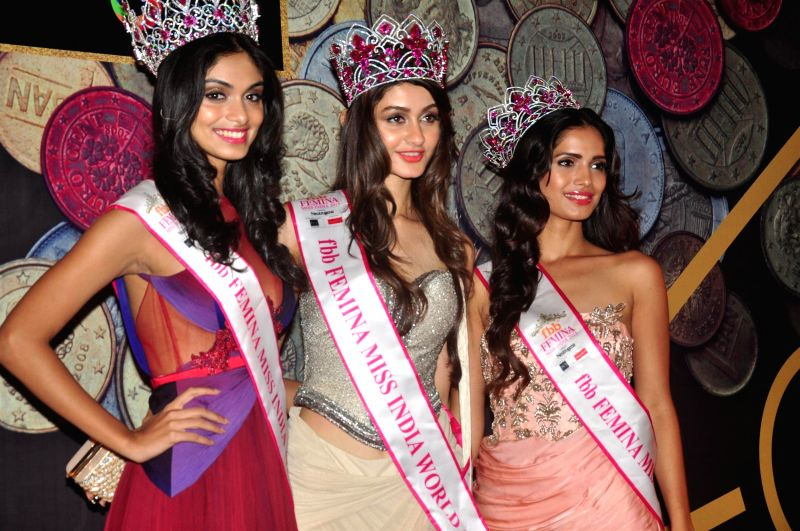 Aditi Arya, Femina Miss India 2015 is flanked by 1st runner up Aafreen Rachel Vaz (L) and 2nd runner up Vartika Singh at the NRI of the year awards, in Mumbai on April 10, 2015. - Vartika Singh