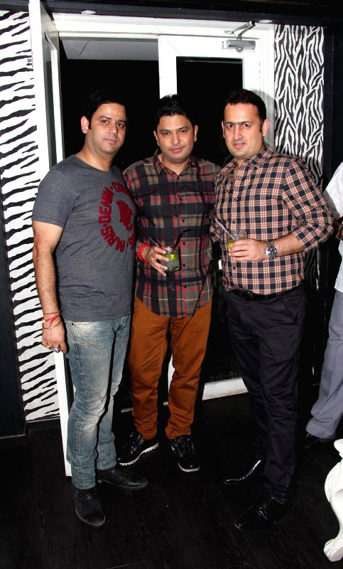 Ajay Kapoor, Bhushan Kumar and Vinod Bhanushali at Divya Khosla Kumar`s birthday bash in Mumbai, on November 20, 2014. - Ajay Kapoor and Bhushan Kumar