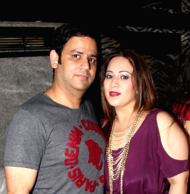 Ajay Kapoor with wife Ekta Kapoor at Divya Khosla Kumar`s birthday bash in Mumbai, on November 20, 2014. - Ajay Kapoor and Ekta Kapoor