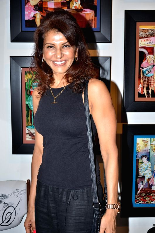 Anita Raj during opening of a cartoon gallery ``aPaulogy`` by Paul Fernandes in Mumbai on Dec 13, 2014.