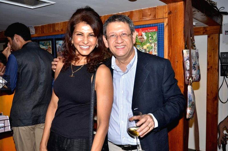 Anita Raj with owner Shyam Ganatra during opening of a cartoon gallery ``aPaulogy`` by Paul Fernandes in Mumbai on Dec 13, 2014.