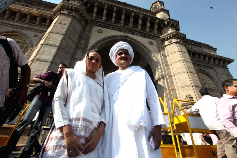 Artists disguised as Mahatma Gandhi and Kasturba Gandhi enact the scene of Mahatma Gandhi`s return from South Africa at the Gateway of India to mark the centenary of the event in Mumbai, on .. - Kasturba Gandhi