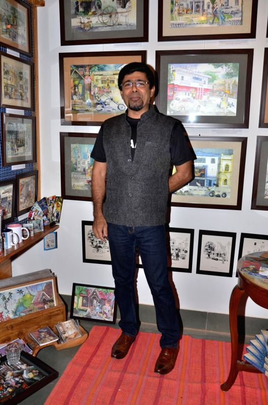 Arzan Khambata during opening of a cartoon gallery ``aPaulogy`` by Paul Fernandes in Mumbai on Dec 13, 2014.