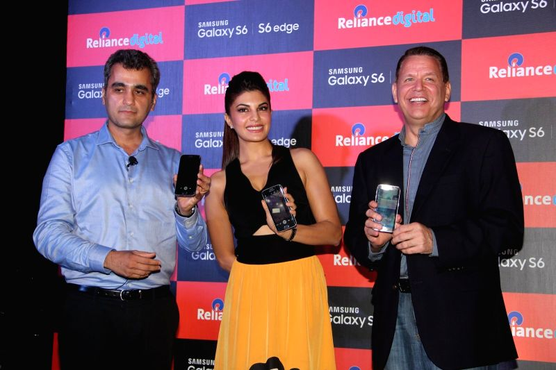 Asim Warsi, Vice President, Samsung India, actress Jacqueline Fernandez and Brian Bade, CEO, Reliance Digital, during the launch of Samsung Mobile S6 and S6 Edge in Mumbai on April 10, 2015.