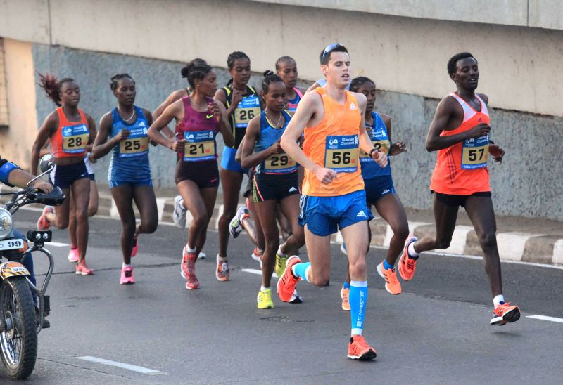 Athletes participate in Mumbai Marathon 2015 on Jan 18, 2015.