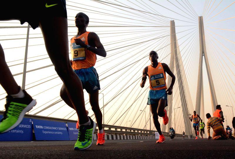 Athletes participate in Mumbai Marathon 2015 on Jan 18, 2015.