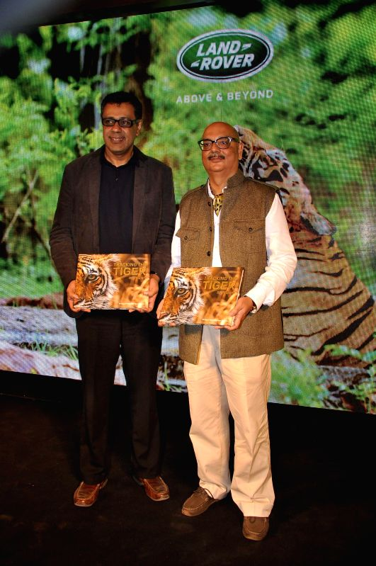Author Bob Rupani with Rohit Suri (L), VP, Jaguar Land Rover India during the launch of the book Tracking the Tiger written by Bob Rupani in Mumbai, on Nov 18, 2014.
