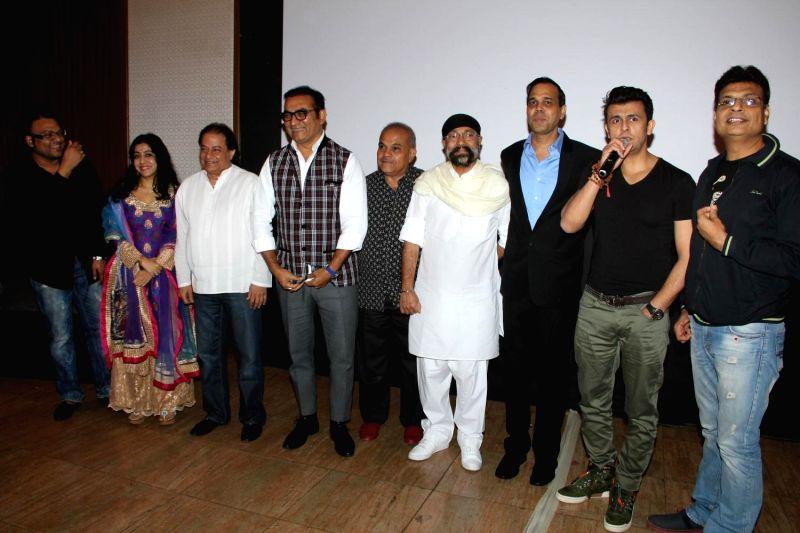 Author Irshad Kamil, bhajan singer Anup Jalota, singers Sunidhi Chauhan, Sandesh Shandilya, Sonu Nigam and Abhijeet Bhattacharya during the success of the World Music Symphony in Mumbai on ... - Sonu Nigam and Sunidhi Chauhan