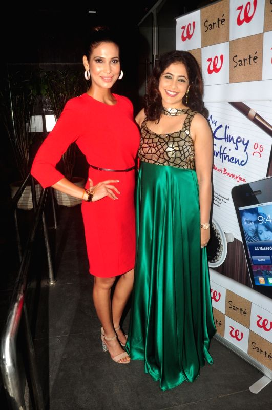 Author Madhuri Banerjee with Femina Miss India Earth 2012, Prachi Mishra during launch of her book My Clingy Girlfriend in Mumbai on 7 April 2015. - Madhuri Banerjee and Prachi Mishra
