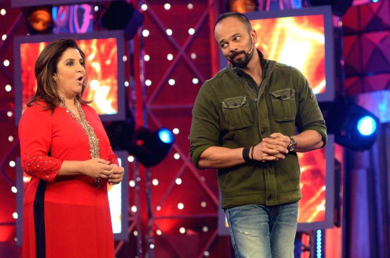Bigg Boss Season 8 host Farah Khan with film director Rohit Shetty  on Jan. 31, 2015. - Farah Khan and Rohit Shetty