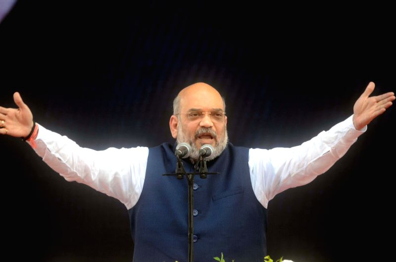 :Mumbai: BJP chief Amit Shah addresses during a rally organised to celebrate BJP's 38th Foundation Day in Mumbai on April 6, 2018. .