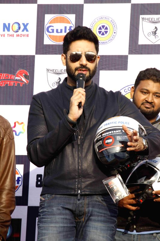 Bollywood actor Abhishek Bachchan cheers and support for the cause of Ride for Safety event, in Mumbai, on Dec 21, 2014.