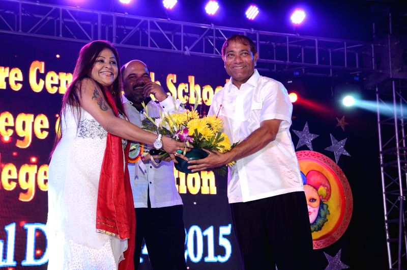 Brazilian singer Carlyta Mouhini with Prashant Kashid and Principal Ajay Kaul during the 34th annual day celebration of Children`s Welfare Centre High School in Mumbai, on Feb 15, 2015.