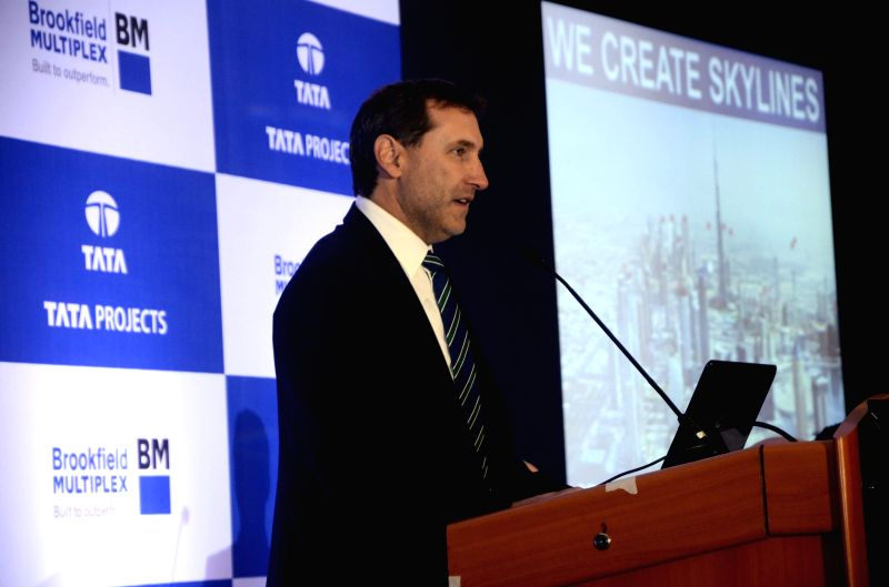 Brookfield Multiplex Australasia CEO John Flecker addresses during a programme organised to announce a tie up between Tata Projects and Brookfield Multiplex in Mumbai on April 23, 2015.
