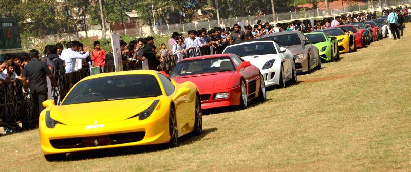 Cars on display at `Parx Super Car Show` at Mahalaxmi Race Course, in Mumbai, on Jan 10, 2015.