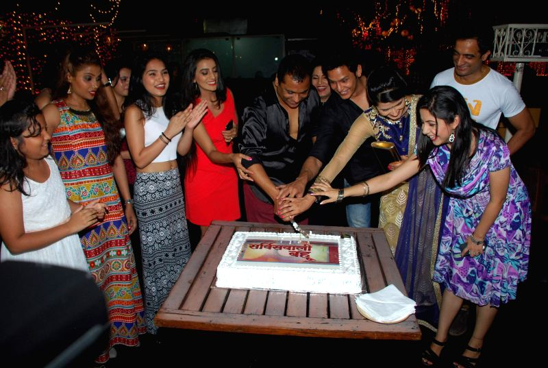 Cast of Service Wali Bahu, cut a cake during the launch party of Zee TV new show Service Wali Bahu in Mumbai on Feb 23, 2015.