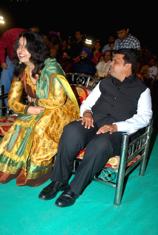 Chief Minister Devendra Fadnavis with his wife Amruta Fadnavis during singer Sonu Nigam live concert to celebrate Republic Day in Mumbai, on Jan 26, 2015. - Devendra Fadnavis