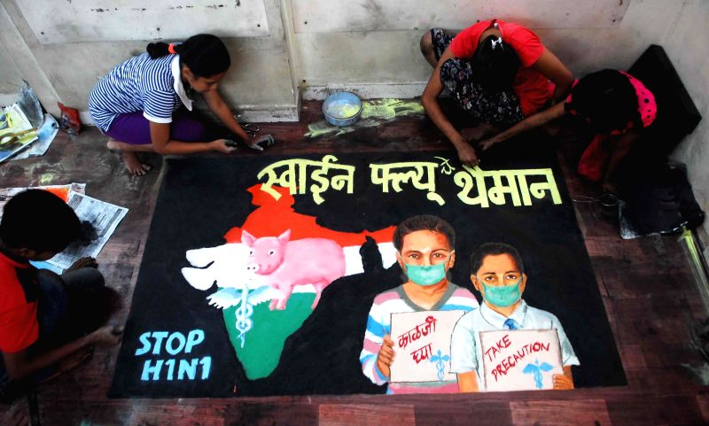 Children make rangoli on swine flu awareness in Mumbai, on Feb 12, 2015.