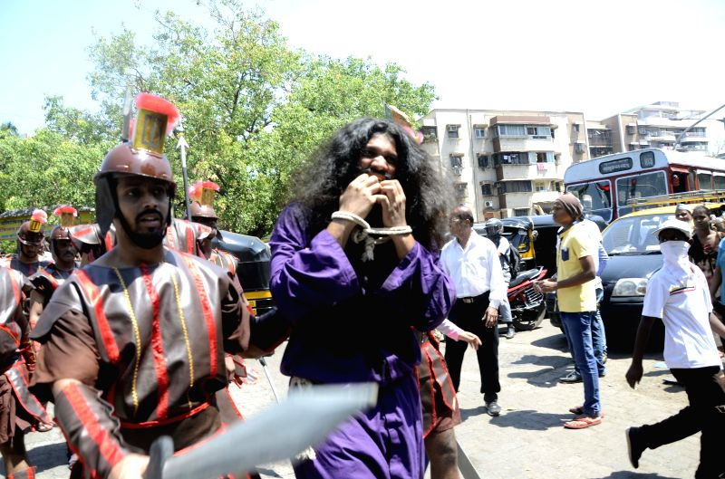 Christians participate in a procession organised by The Catholic - Christian Secular Forum (CSF) on Good Friday at Santacruz in Mumbai, on April 3, 2015.