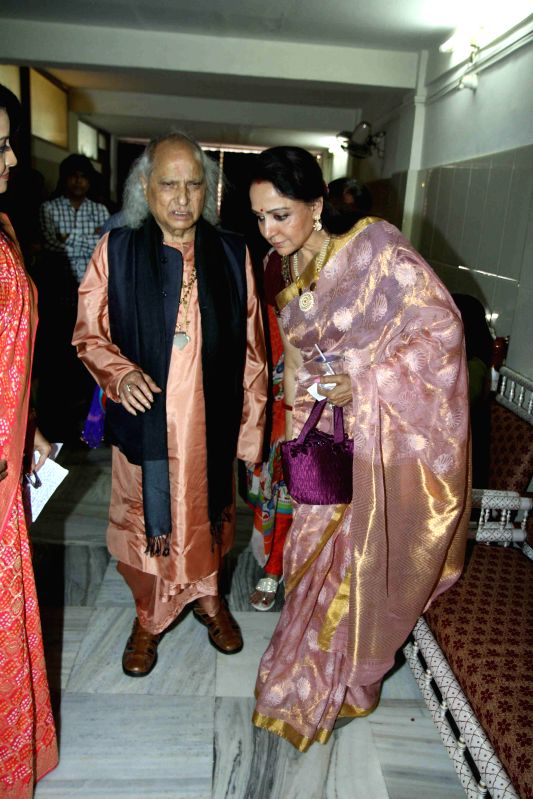 Classical singer Pandit Jasraj and actress Hema Malini during the launch of Dr.Veena Mundhra's Shri Hari Vani Gita devotional album and book in Mumbai on Feb 22, 2015. - Hema Malini