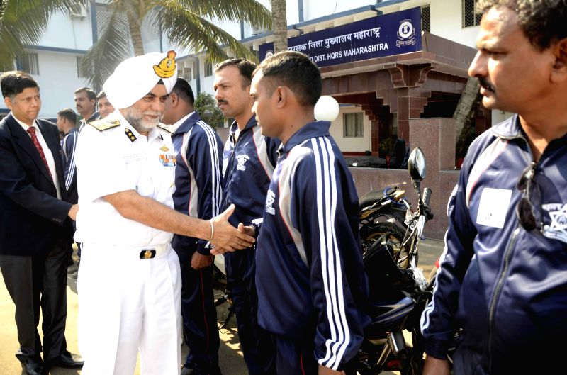 Coast Guard Region (West) Commander Inspector General SPS Basra meets with coast guards during a programme organised to flag-off a Motor Cycle Rally in Mumbai, on Dec 23, 2014.