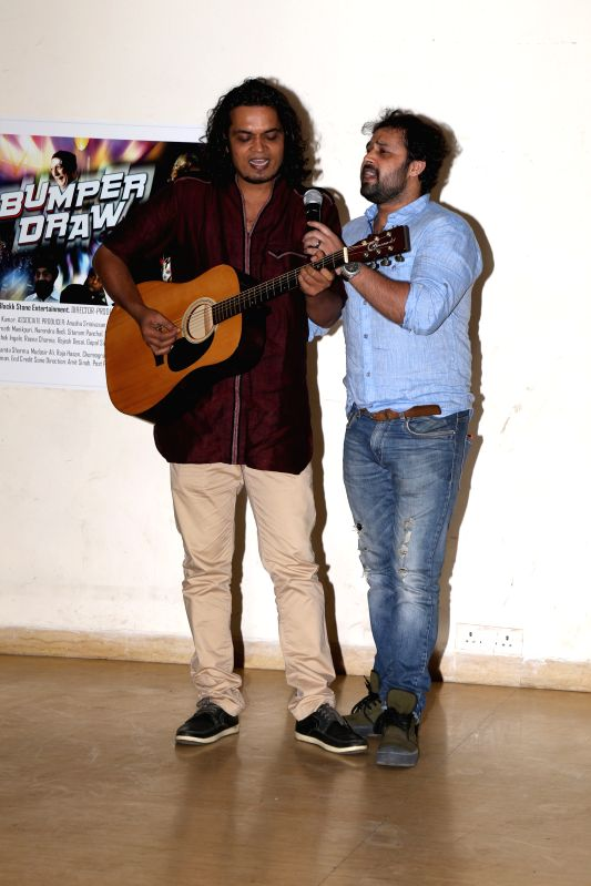 Composer Rahul Mishra with singer Mudasir Ali during the film Bumper Draw completion party in Mumbai on April 26, 2015. - Rahul Mishra