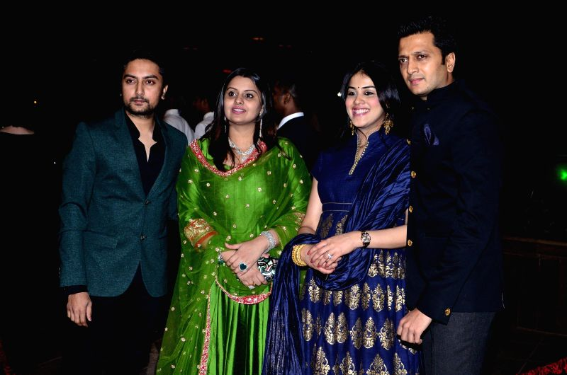 Congress leader Dheeraj Deshmukh with wife Honey Bhagnani, actor Riteish Deshmukh with wife Genelia D'Souza family during Arpita Khan's marriage reception in Mumbai on November 21, 2014. - Riteish Deshmukh, Genelia D'Souza and Dheeraj Deshmukh