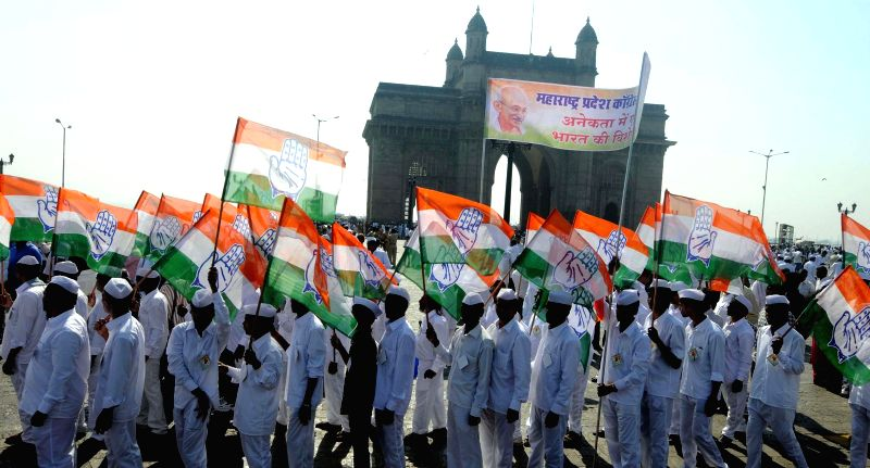 Congress workers participate in Prerna Yatra to celebrate the centenary of arrival of Mahatma Gandhi from South Africa, at Gateway of India in Mumbai, on Jan 9, 2015.